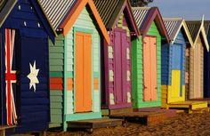 Colourful beach huts in a row