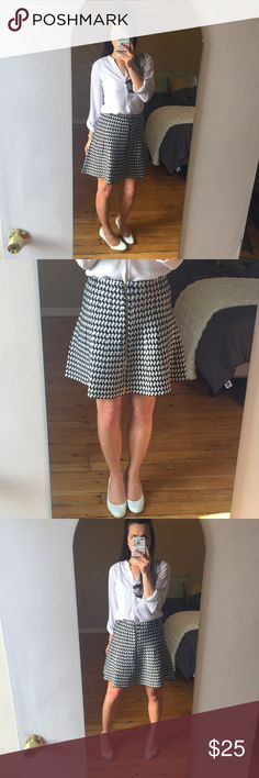 """Black & White Front Zipper Houndstooth Skirt Adorable above the knee houndstooth skirt with front zipper.  Hemline sits at mid-thigh.  Soft cotton material feel with a mid rise fit.  Materials: 78% Rayon 22% Polyester  Measurements (of Medium): 28.5"""" waist 39"""" hip  🚫Trades XOXO Skirts"""