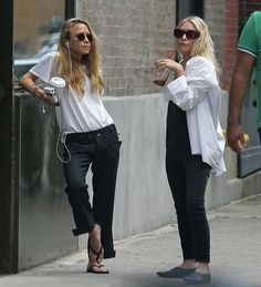 Mary-Kate channeled her inner James Dean in a slouchy tee and trouser ensemble that is amped up by retro round shades and an armful of beaded bracelets. Ashley also took a cue from the boys in an oversize oxford shirt that acts as the perfect protector from strong summer gusts. But what stole the show are the footwear choices: While Mary-Kate opted for pedi-friendly flip-flops, Ashley slipped into Moroccan-inspired point-toe babouches for an urban spin on Eastern influences. For the…