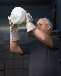 Rejuvenation Detail: an American glass artisan handcrafts one of our Opal drum shades