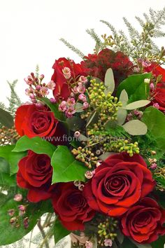 Twelve premium roses in a hand-tied bouquet beautifully complemented luxe filler flowers and greens. Available in all colour roses.