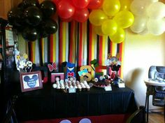 Black, red, yellow and white balloons