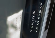 Door signage for Craftsman and Wolves // design by CDA // chendesign.com