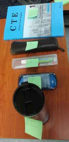 These are my stuffs in my bag. The blue book is about Employment. Second one is a just Pencil case and third one is also a just toothbrush. Fourth is a just glasses case. Last one is my water bottle from my father.