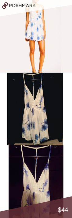 "NWT ""Collette Dress""  NWT - ""Collette Dress"" by Lovecat. Blue and white floral print. Size S. Lovecat Dresses"