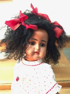 This little gal has a gorgeous creamy brown complexion, dark brown eyes and a curly mohair skin wig. She is dressed in antique clothing and shoes. She is in great shape with no hairlines or repairs. | eBay!