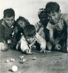 Children playing marbles. 1940.  original source unknown