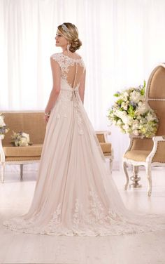 Essense of Australia's lace over matte-side Lustre satin A-line wedding gown features sparkling beading, elegant cap sleeves in lace, and an illusion back.