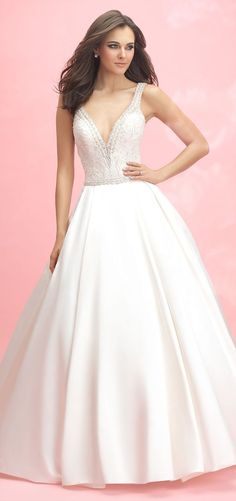 The sparkle of beaded embroidery is softened by this ballgown's unembellished satin skirt.