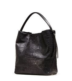 """Simultaneously slouchy and sophisticated, this fab hobo is the perfect way to add a casual-chic flair to your look, from cuffed trousers to a breezy swing dress.  Over-the-shoulder hobo bag with open top 13"""" W x 12"""" H x 7"""" D Black nappa strap hangs 5"""" from shoulder Black Pony, Nero Soft Croco Large inside zip pocket, inside patch pocket, and cell phone pocket SW signature leopard printed nylon lining Made in Spain"""