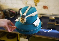 While in New York for Fashion Week, I had the pleasure of meeting milliner Lola Ehrlich of Lola Hats at her Brooklyn atelier. Nestled in the heart of Bushwick's growing street art scene, Lola's spacious workshop is bustling with a small group of artisans aiming to preserve the art of the handmade hat. I was in awe after witnessing the age-old process of molding a classic felt fedora around one of her many vintage wooden hat molds, the felting techniques used on her chic leo