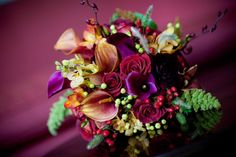 red, purple and gold bouquet