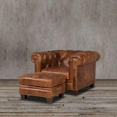 This dark walnut set of chesterfield arm chair and ottoman features a traditional charm with its nailhead trim ,rolled arms and tufted back that will surely add grandeur to your living space.