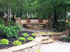 A wood bench and mixture of materials adds a rustic touch to this custom fire pit area by Hearthstone Environments .