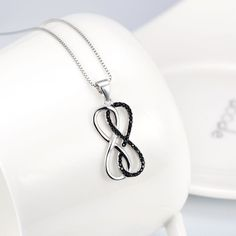 This stylish necklace is a must have for any infinity lover. Made of 925 sterling silver with black cubic zirconia accents, this beautiful pendant is perfect fo