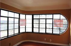 Living room of Streamline Modern house in North St. Streamline Moderne, Steel Windows, Living Room Remodel, Window Frames, Art Deco, Ceiling Lights, St Louis, Interior, House