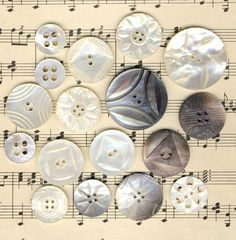 (::) Love this display of vintage carved pearl buttons