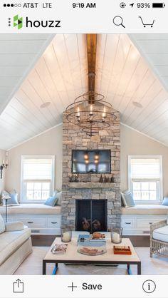 Window seats by fireplace