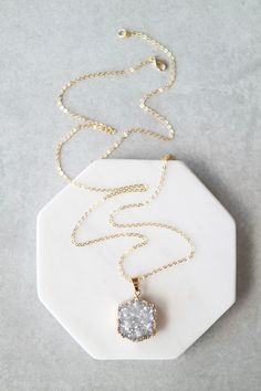"Up your long necklace game with this Druzy hex pendant. Details: - 28"" - Lobster clasp closure - Gold plated metal chain"