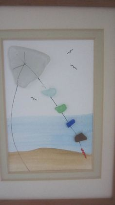 SEA GLASS *** BEACH GLASS *** FLYING KITE FRAMED PICTURE This sea glass FLYING KITE picture is made with all real Jersey Sea Glass... Each piece of glass has been picked up by me on the Jersey Shore... We then add our lovely hand painting to the picture to make it a fun , decorative art.. This picture is 3 x 5 with a wood frame that is 7 x 9 . There is a lovely two tone double mat on the picture... This is a beautiful medium tone wood frame . This picture can only be hung. This picture is…