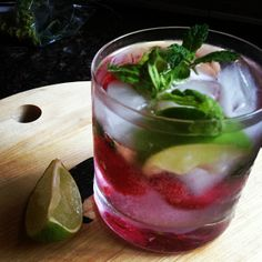 Layer of muddled fresh raspberries and mint, layer of ice, #lacroix, #greygoose with sprigs of basil and mint. #summerferg