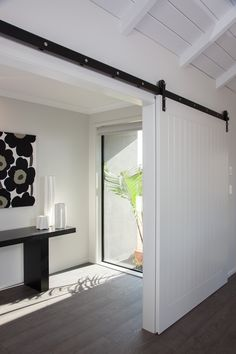 The industrial style door separates the entrance from the open plan living Front Door Handles, Black Door Handles, White Internal Doors, White Doors, Interior Barn Doors, Room Interior, Open House Plans, Diy Barn Door, Kit Homes