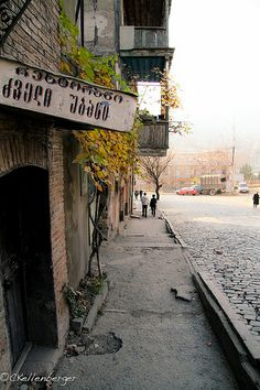 Tbilisi is famous for its 'hanging' wooden balcones and stepped sidewalks - Old Tbilisi, Georgia