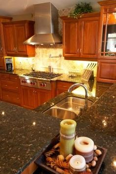 Honey oak cabinets with a deep terra cotta/e colored walls ... on