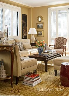 The living room is made up of chairs from Pottery Barn and a Louis XV Salon Chair from Bal...