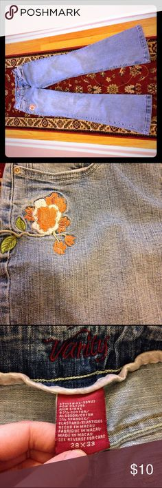 Vanity Floral Jeans Size 28x33 Size 28x33 jeans from Vanity. Made in Macau. The material is 97% cotton, 3% spandex. Machine wash, tumble dry. The cuffs have dirt, wear and fraying. The pink interior piping by waist is wearing, velvety texture worn off in sections and dirty. Material flaws in material. The back flower has gaps in the thread and loose threads. Comfortable cute jeans. Vanity Jeans
