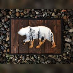 A bear cutout on reclaimed wood with a foggy autumn morning painted within. Measures at 14x18