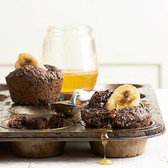 Dark Cocoa Banana Muffins: Indulge in chocolate for breakfast, guilt-free! Start your day with these rich, chocolaty muffins loaded with chunks of fresh banana and finished with a drizzle of honey.