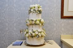 Simply stunning floral arrangements for a wedding cake. Central Coast Wedding at Bells at Killcare   Photography by Impact Images   For more photos, check out www.impact-images.com.au