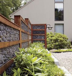 gabion-with-wood-framing -- why not use free pallets and rocks from the yard.