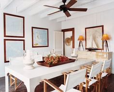 A locally made dining table and Pottery Barn director's chairs echo the breezy simplicity of India Hicks and David Flint Wood's Harbor Island guesthouse.