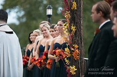 We love these fall colored bouquets against the Navy dresses