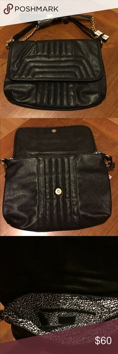 "NWT CESCA London Faux Leather Shoulder Bag Guaranteed Authentic. New, never worn; with tag. Black faux leather shoulder/Crossbody bag. Can be worn with a shoulder strap, or be replaced by a longer strap for crossbody. Opens by snap closure. Interior is lined, and has a zipped pocket, with two patch pockets. 12.5""L, 8.5""H, 2""D. NO TRADES. Open to offers through the offer button ☺️ Cesca Bags Shoulder Bags"