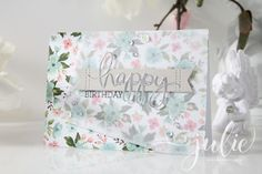 handmade birthday card from galerie@handmadebyjulie.de .... pretty flowered paper base ... vellum off-the-corner design .. mixed font greeting with die cut HAPPY and stamped BIRTHDAY ... delightful card ...