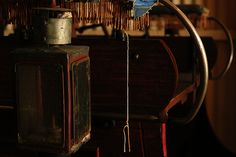 Photograph taken of an old vintage lamp on a cart  #background #vintage #old #rusty #wood #wallpaper #reflection