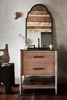 Fusing together natural materials in a streamlined silhouette, this vanity is the epitome of contemporary bathroom luxury. The coarse, straight grain of its oak and poplar veneer is modernized with stout steel hardware and a polished black marble top, while two drawers and roomy open storage accommodate your toiletries and bath linens with ease.