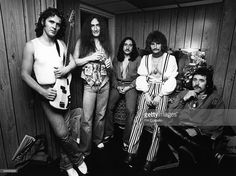 Photo of Lee KERSLAKE and URIAH HEEP and John WETTON and Ken HENSLEY and Mick BOX and David BYRON; Posed group portrait backstage L-R John Wetton, Ken Hensley, Mick Box, David Byron and Lee Kerslake