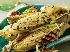 Grilled Corn with Roasted Garlic and Herbs|KitchenDaily.com   (lemon zest, butter, cilantro and tarragon)