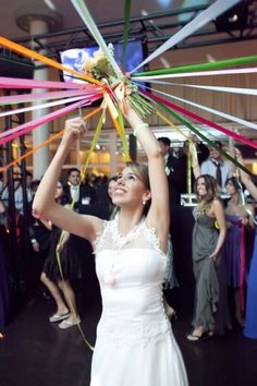 """Alternative to tossing the bouquet. Tie it and have each """"eligible"""" lady hold their own ribbon. The bride cuts the ribbons, one by one. The last lady with her ribbon uncut gets the bouquet!"""