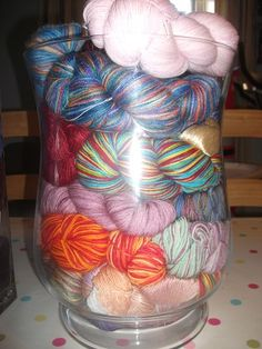 I like the idea of storing yarn (or anything colorful) in jars