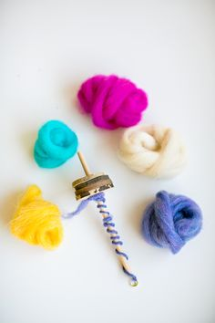 Make a Mini Drop Spindle for Kids.  Takes just a few items and so fun for little ones to learn how to spin yarn. Makes a great handmade gift too!