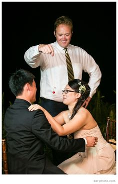Everyone LOVED the Cherry on a String Game at Yuhan and Le's wedding. Photo by Kai Photography.   http://www.hawaiianweddings.net