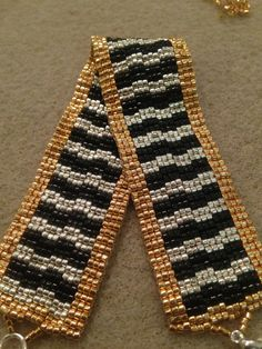 Black silver and gold. Hand made beaded bracelet www.facebook.com/BayouBlingLA