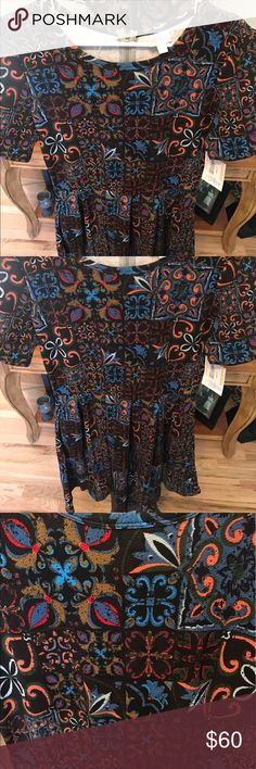 LuLaRoe Amelia XL NWT Beautiful Patchwork Print Gorgeous LuLaRoe Amelia in an amazing Floral and scroll patchwork print.  Medium stretch to fabric. Size XL, NWT, never worn or tried on.   I am selling many pieces from my LuLaRoe collection as it is getting out of control in size.  My loss is your gain.  I am not related in any way to LuLaRoe. LuLaRoe Dresses