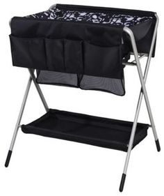 IKEA Spoling Changing Table - folds flat for storage.  Easy to cart around the house.  Great idea!