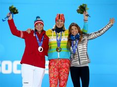 DAY 4:  (L-R) Silver medalist Nicole Hosp of Austria, gold medalist Maria Hoefl-Riesch of Germany and bronze medalist Julia Mancuso of the United States celebrate during the medal ceremony for the Alpine Skiing Women's Super Combined